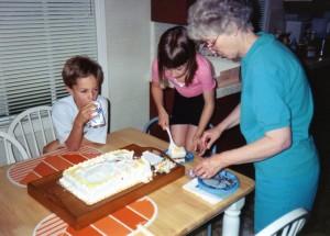 cutting cake with Grandma