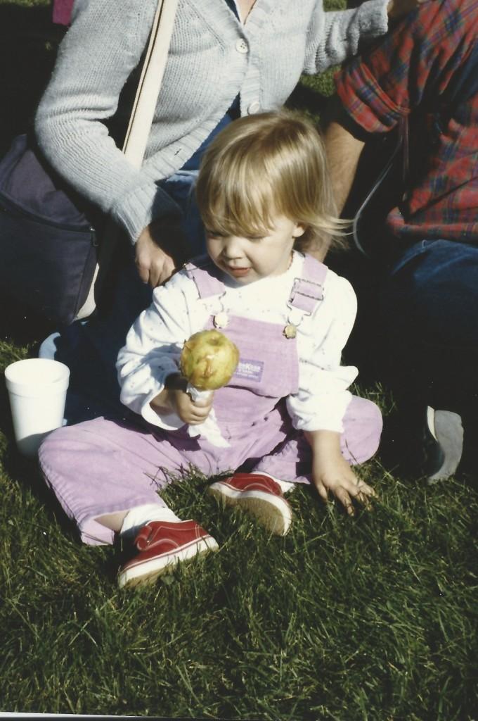 enjoying a caramel apple